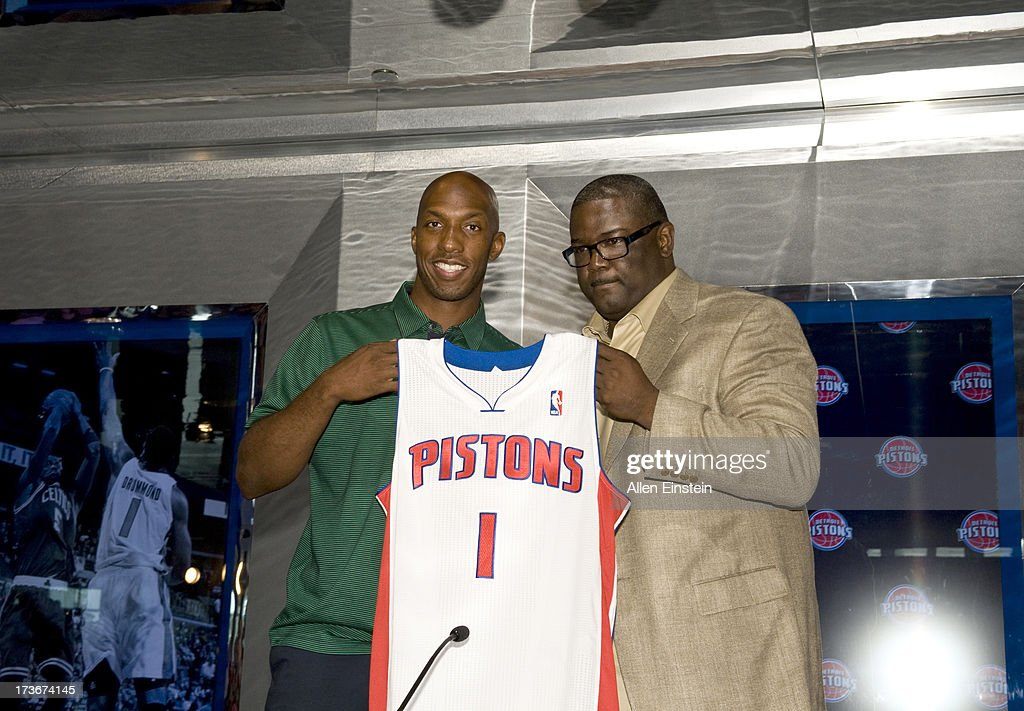 Joe Dumars, President of Basketball Operations (R), presents a new Detroit Piston, Chauncey Billups, with his new jersey at a press conference at Palace of Auburn Hills on July 16, 2013 at Palace of Auburn Hills in Auburn Hills, Michigan.