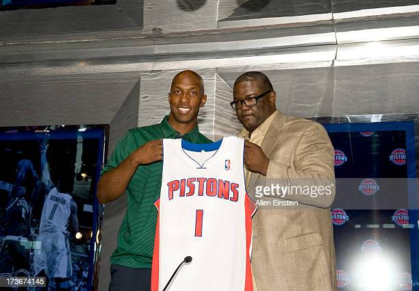 Joe Dumars President of Basketball Operations presents a new Detroit Piston Chauncey Billups with his new jersey at a press conference at Palace of...