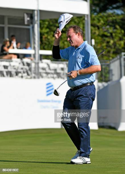 Joe Durant acknowledges the gallery on the 18th hole during the first round of the PGA TOUR Champions Dominion Energy Charity Classic at The Country...