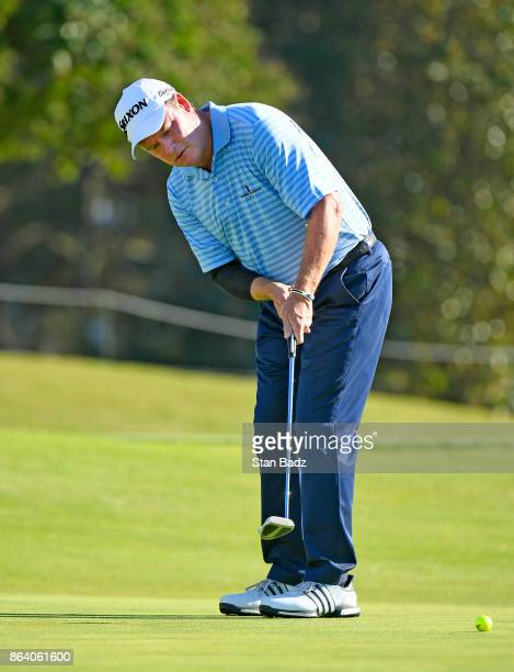 Joe Durant hits a putt on the 18th hole during the first round of the PGA TOUR Champions Dominion Energy Charity Classic at The Country Club of...