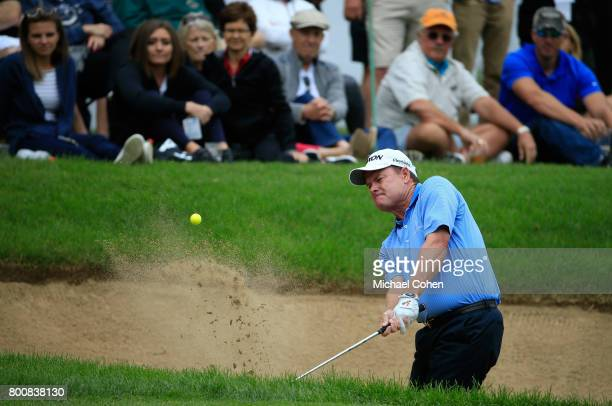 Joe Durant hits his second shot on the 17th hole from a bunker during the third and final round of the American Family Insurance Championship held at...