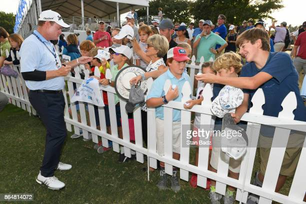 Joe Durant signs autographs for fans after the second round of the PGA TOUR Champions Dominion Energy Charity Classic at The Country Club of Virginia...