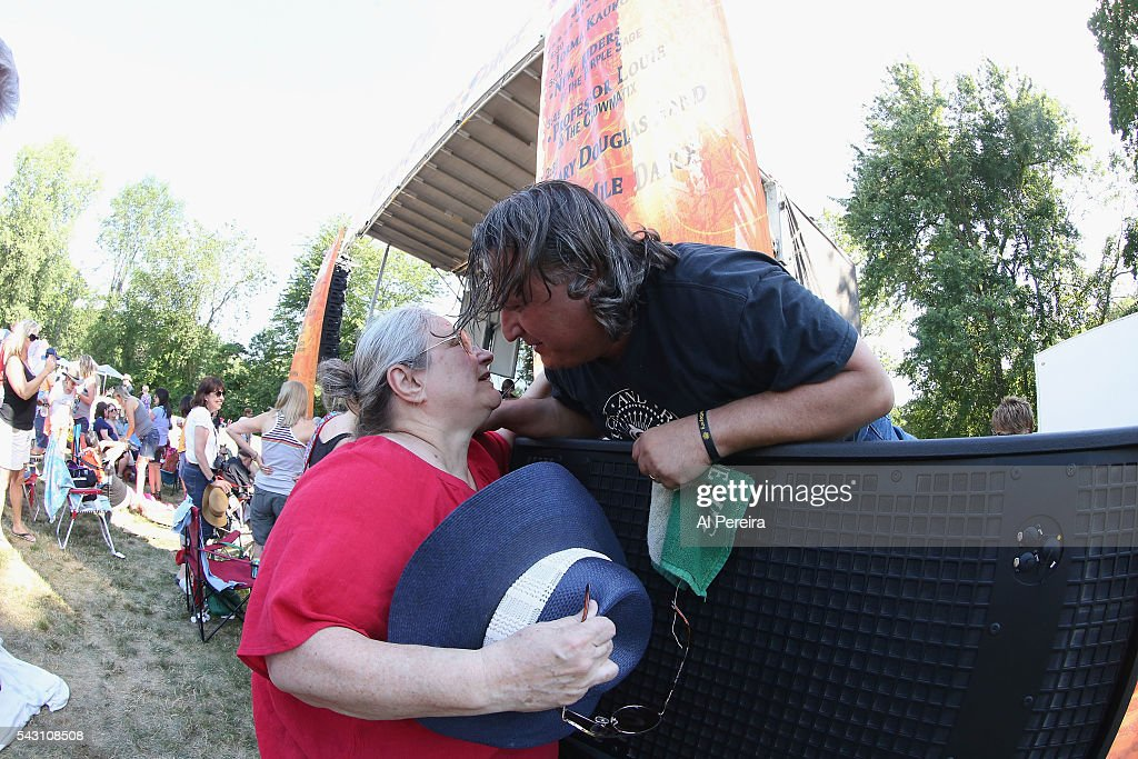 Joe D'Urso greets a fan when he and Stone Caravan peform at Day One of the Rockland-Bergen Music Festival at German Masonic Park on June 25, 2016 in Tappan, New York.