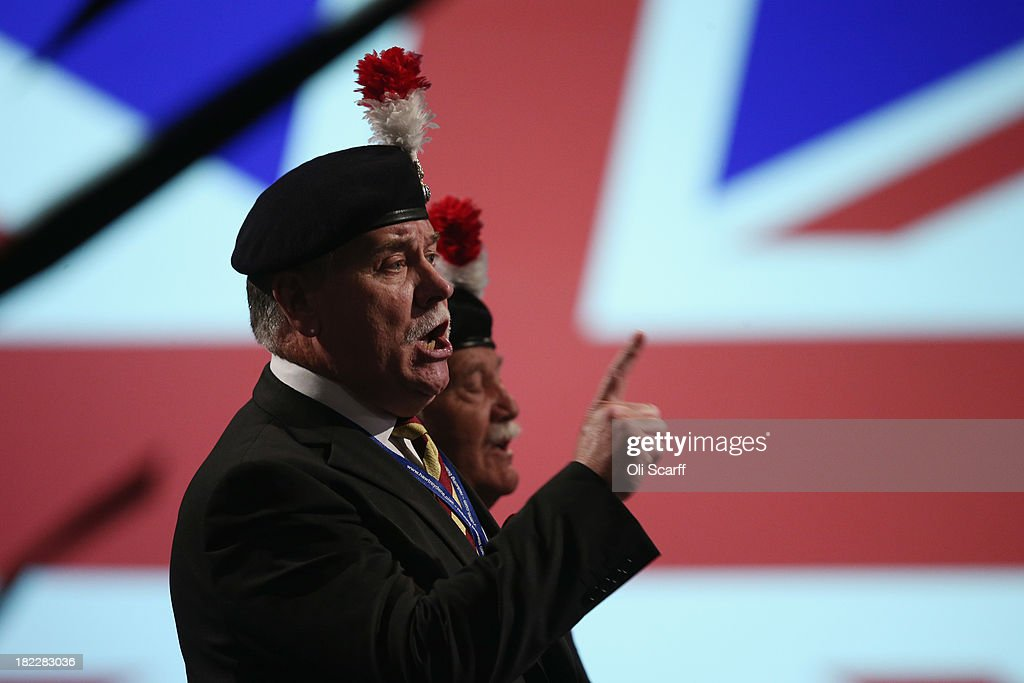Joe Eastwood (R) and Ian Brazier (L) are requested to leave the the main hall on the first day of the Conservative Party Conference after interrupting Defence Secretary Philip Hammond's speech on September 29, 2013 in Manchester, England. The two men were protesting at plans to disband the second battalion of the Royal Regiment of Fusiliers. Mr Cameron has announced that the Government is to bring forward by three months its scheme to assist first-time home buyers in England to take out 95% mortgages.