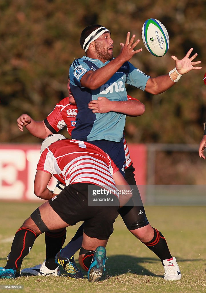 Joe Edwards of the Blues is tackled during the Pacific Rugby Cup match between the Blues Development and Junior Japan at Bell Park on March 28, 2013 in Auckland, New Zealand.