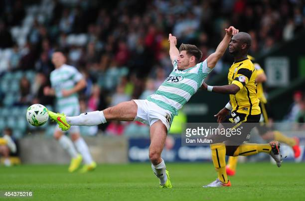 Joe Edwards of Yeovil Town leaps to control the ball under pressure from Leroy Lita of Barnsley during the Sky Bet League One match between Yeovil...