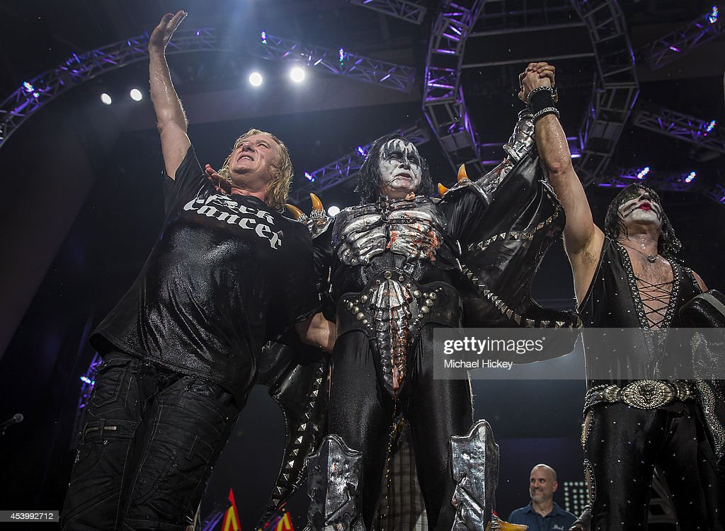 Joe Elliott of Def Leppard Gene Simmons and Eric Singer of KISS wave to the crowd after participating in the ALS Ice Bucket Challenge at Klipsch...