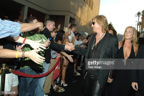 Joe Elliott of Def Leppard with guest and fans during 2006 VH1 Rock Honors Arrivals at Mandalay Bay Hotel and Casino in Las Vegas Nevada United States