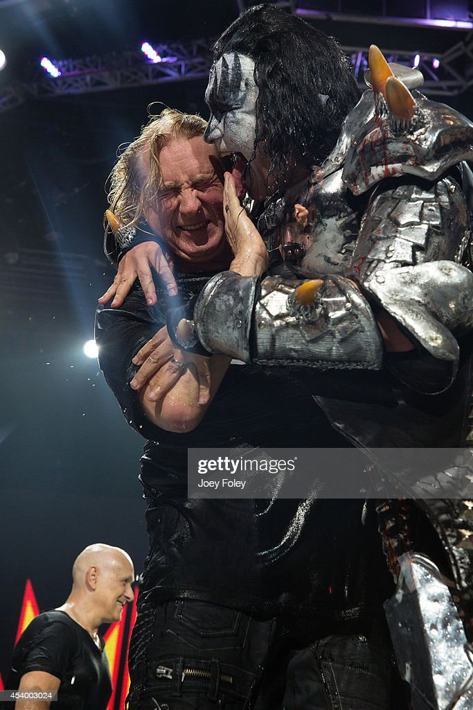 Joe Elliott of rock band Def Leppard and Gene Simmons of the rock band KISS participates in the ALS Ice Bucket Challenge at Klipsch Music Center on...
