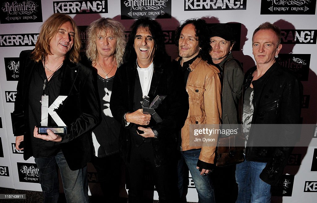 Joe Elliott, Rick Savage, Vivian Campbell, Rick Allen and Phil Collen of Def Leppard, with the Kerrang Inspiration Award, pose with the Kerrang Icon Award winner Alice Cooper (3rdL), at The Relentless Energy Drink Kerrang! Awards at The Brewery on June 9, 2011 in London, England.