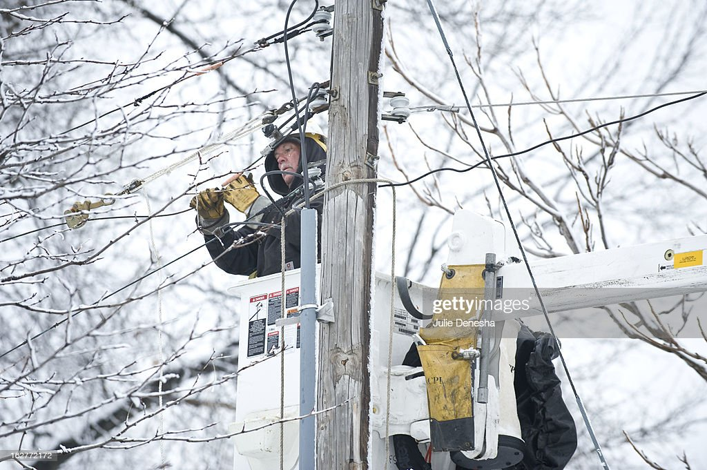 Joe Equels, of Kansas City Power and Light, works to repair a line after a snowstorm hit the midwest February 26, 2013 in Prairie Village, Kansas. This is the second major snowstorm the midwest has seen this week dropping a half-foot or more of snow across Missouri and Kansas and cutting power to thousands.