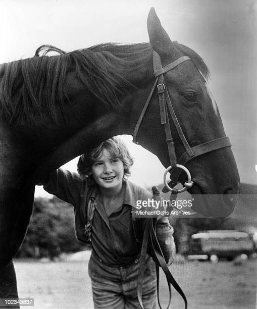 Joe Evans with his black stallion in a scene from the movie 'Black Beauty' which was released in 1971