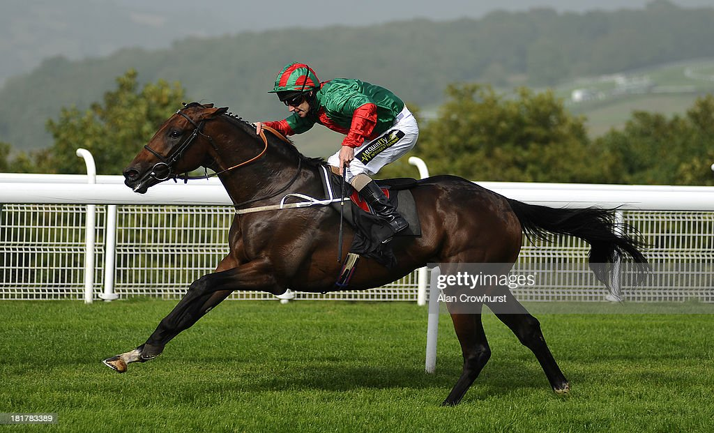 Joe Fanning riding Double Bluff win The Bibendum EBF Maiden Stakes at Goodwood racecourse on September 25, 2013 in Chichester, England.