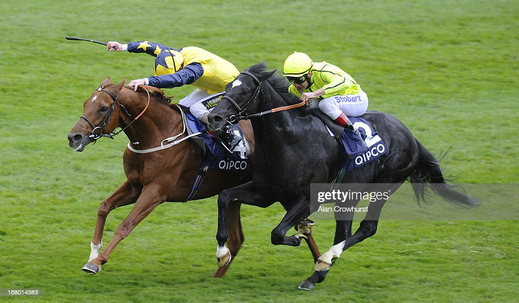 Joe Fanning riding Universal (L) win The Qatar Bloodstock Jockey Club Stakes from Dandino (R) at Newmarket racecourse on May 04, 2013 in Newmarket, England.