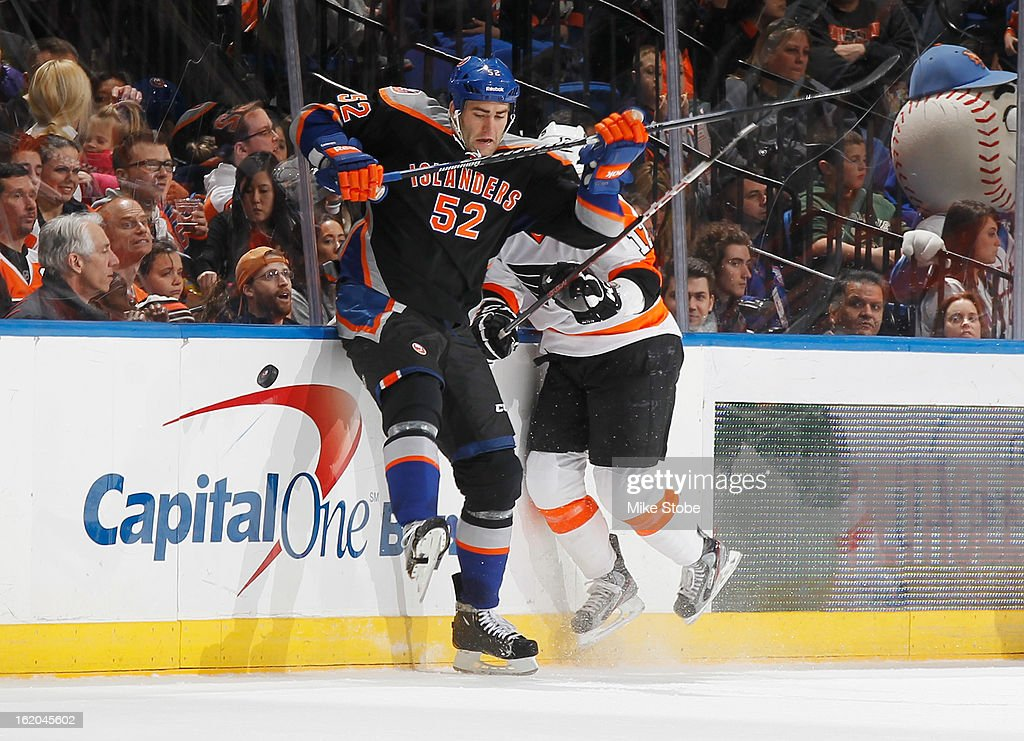 Joe Finley #52 of the New York Islanders skates against <a gi-track='captionPersonalityLinkClicked' href=/galleries/search?phrase=Wayne+Simmonds&family=editorial&specificpeople=4212617 ng-click='$event.stopPropagation()'>Wayne Simmonds</a> #17 of the Philadelphia Flyers at Nassau Veterans Memorial Coliseum on February 18, 2013 in Uniondale, New York. The Islanders were shut out by the Flyers 7-0.
