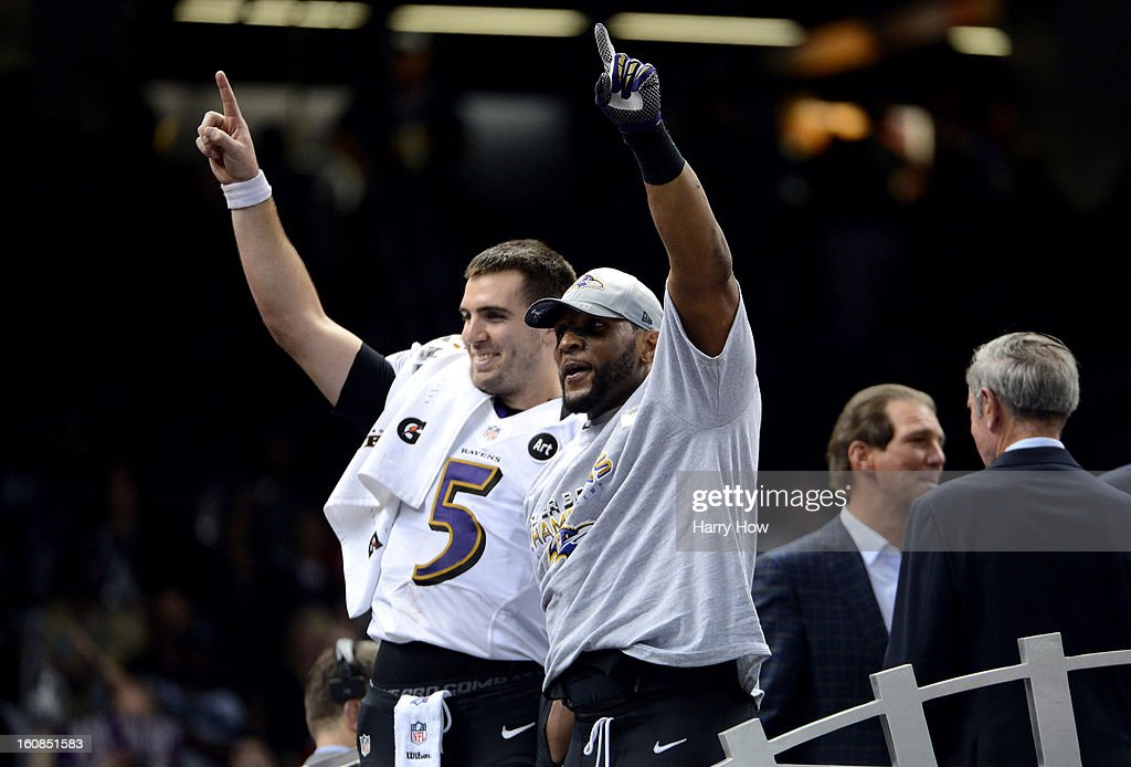 Joe Flacco #5 and Ray Lewis #52 of the Baltimore Ravens celebrate after the Ravens won 34-31 against the San Francisco 49ers during Super Bowl XLVII at the Mercedes-Benz Superdome on February 3, 2013 in New Orleans, Louisiana.