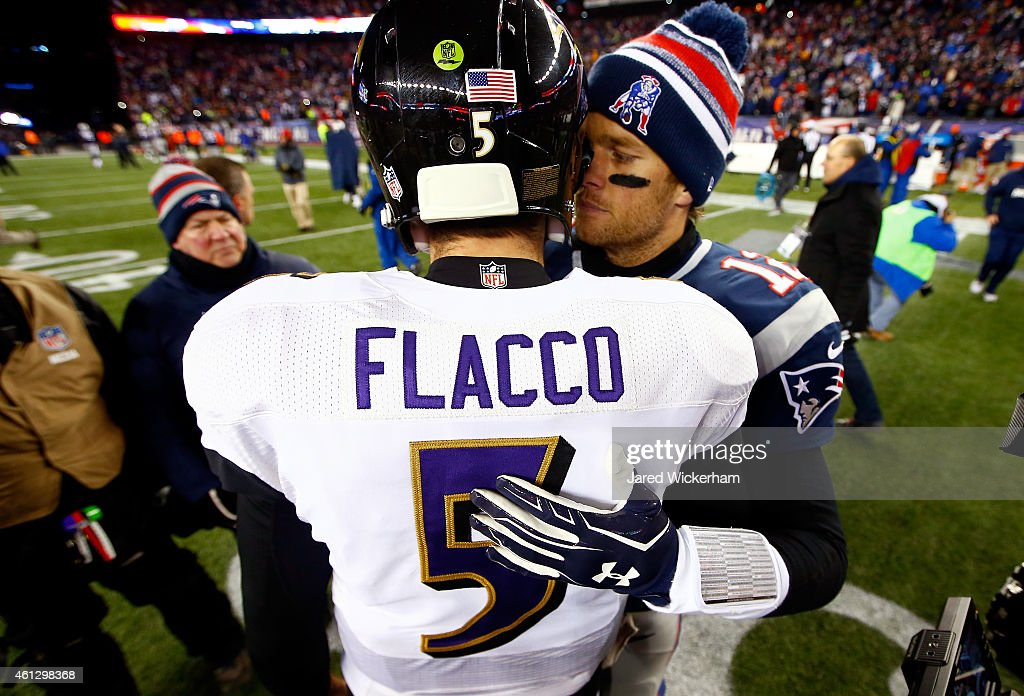 Joe Flacco of the Baltimore Ravens and Tom Brady of the New England Patriots hug following the 2015 AFC Divisional Playoffs game at Gillette Stadium...