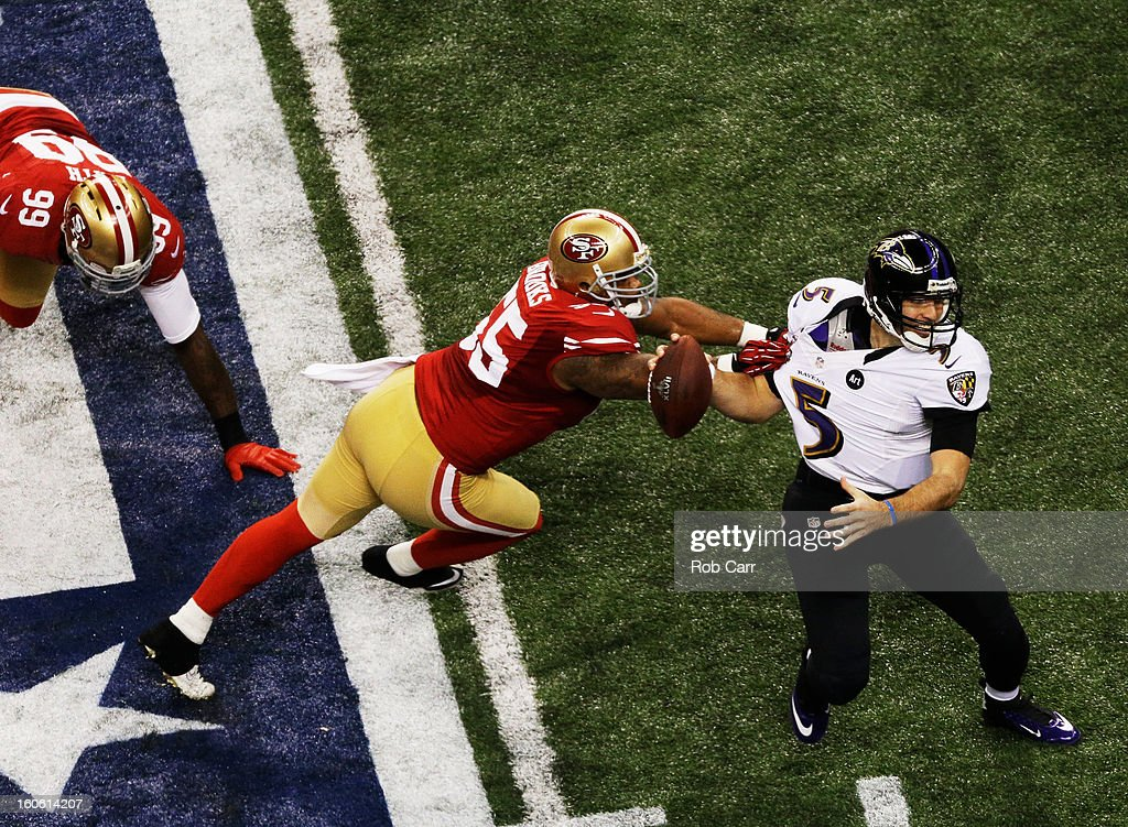 Joe Flacco #5 of the Baltimore Ravens attempts to escape the pressure from Ahmad Brooks #55 of the San Francisco 49ers in the second quarter during Super Bowl XLVII at the Mercedes-Benz Superdome on February 3, 2013 in New Orleans, Louisiana.