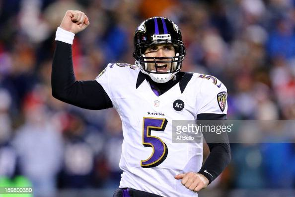 Joe Flacco of the Baltimore Ravens celebrates after throwing a touchdown pass to Anquan Boldin in the fourth quarter against the New England Patriots...