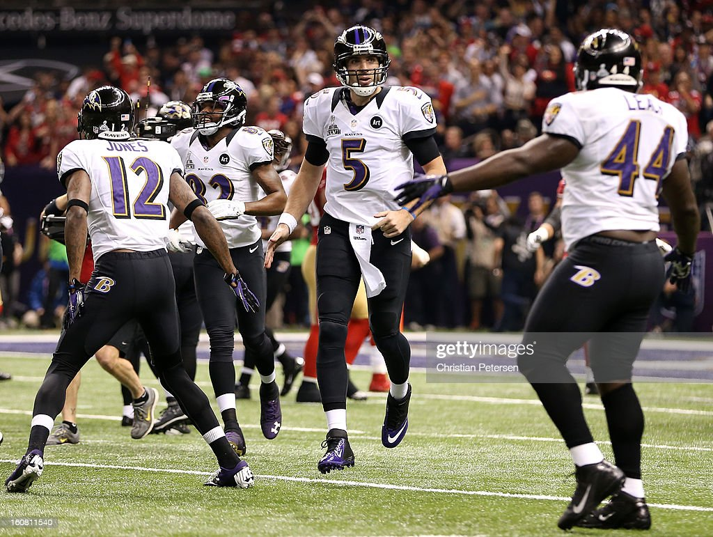 Joe Flacco of the Baltimore Ravens celebrates with Jacoby Jones and Vonta Leach after Flacco threw a 13yard touchdown pass to Anquan Boldin in the...