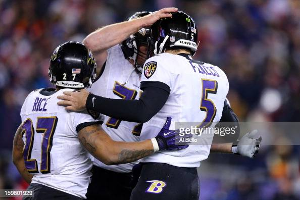 Joe Flacco of the Baltimore Ravens celebrates with teammates Matt Birk and Ray Rice after throwing a touchdown pass to Anquan Boldin in the fourth...