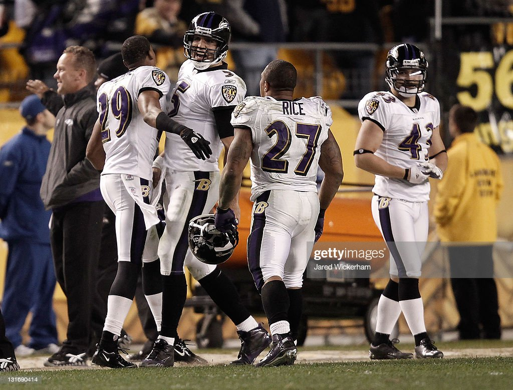 <a gi-track='captionPersonalityLinkClicked' href=/galleries/search?phrase=Joe+Flacco&family=editorial&specificpeople=4645672 ng-click='$event.stopPropagation()'>Joe Flacco</a> #5 of the Baltimore Ravens celebrates with teammates <a gi-track='captionPersonalityLinkClicked' href=/galleries/search?phrase=Ray+Rice&family=editorial&specificpeople=3980395 ng-click='$event.stopPropagation()'>Ray Rice</a> #27 and Cary Williams #29 after throwing the game winning touchdown against the Pittsburgh Steelers during the game on November 6, 2011 at Heinz Field in Pittsburgh, Pennsylvania.