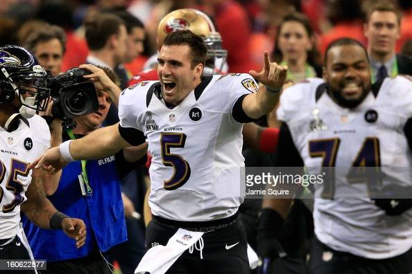 Joe Flacco of the Baltimore Ravens celebreates with his teammates after defeating the San Francisco 49ers during Super Bowl XLVII at the MercedesBenz...