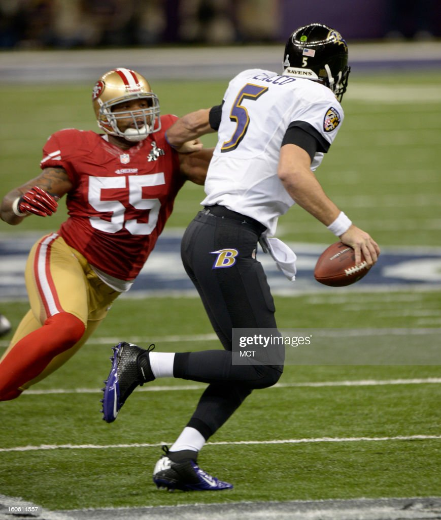 Joe Flacco (5) of the Baltimore Ravens fends off Ahmad Brooks (55) of the San Francisco 49ers during first-half action in Super Bowl XLVII at the Mercedes-Benz Superdome in New Orleans, Louisiana, Sunday, February 3, 2013.