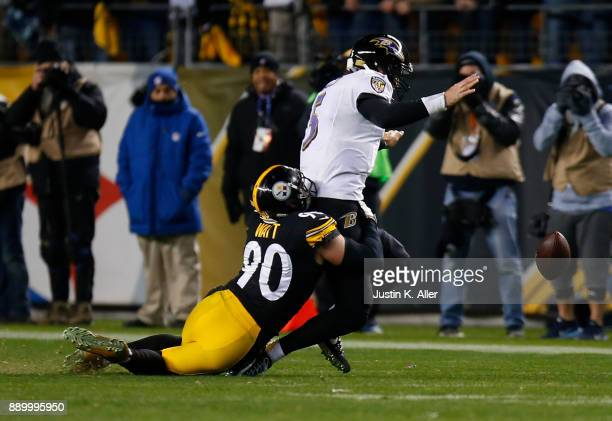 Joe Flacco of the Baltimore Ravens fumbles as he is sacked by TJ Watt of the Pittsburgh Steelers in the fourth quarter during the game at Heinz Field...