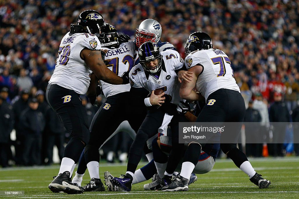 Joe Flacco #5 of the Baltimore Ravens gets sacked by Rob Ninkovich #50 of the New England Patriots in the second quarter during the 2013 AFC Championship game at Gillette Stadium on January 20, 2013 in Foxboro, Massachusetts.