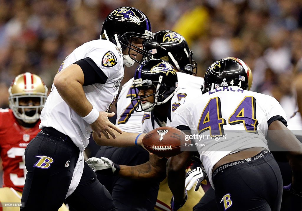 Joe Flacco of the Baltimore Ravens hands the ball off to teammate Vonta Leach in the first quarter against the San Francisco 49ers during Super Bowl...