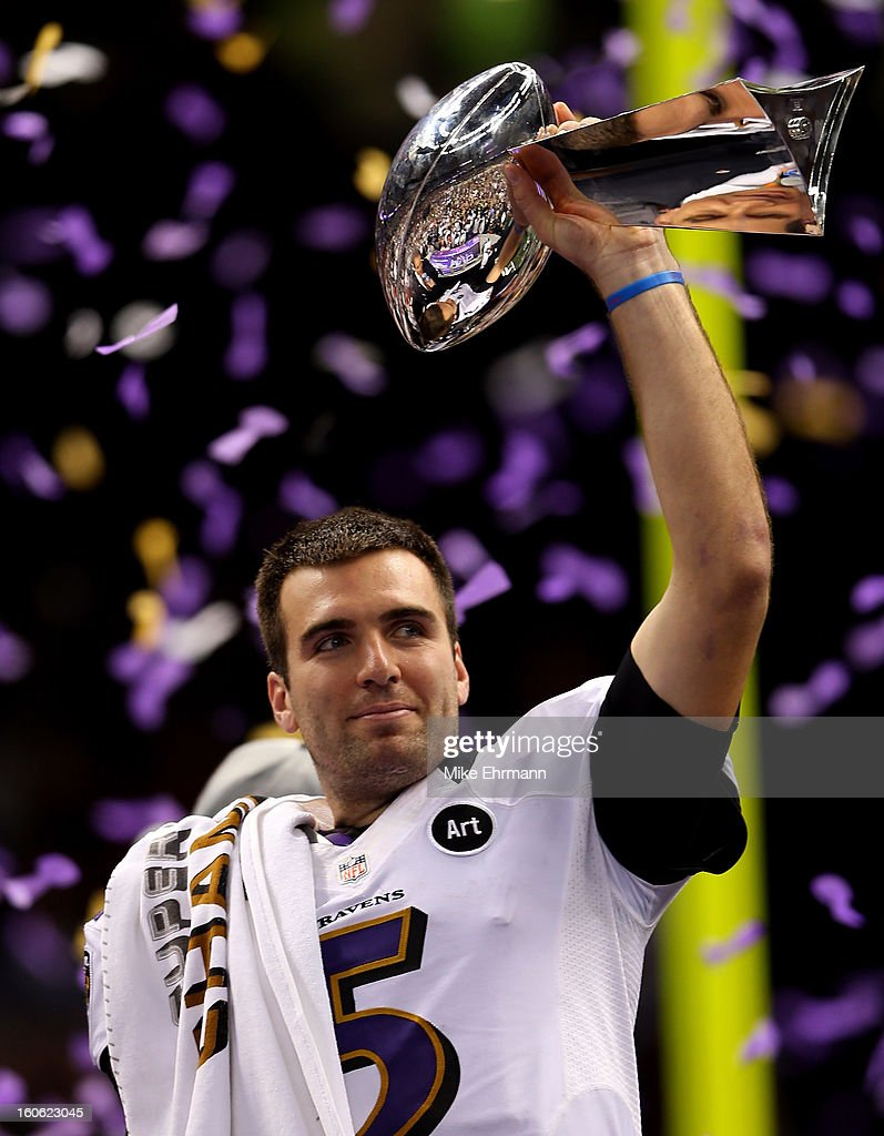 Joe Flacco #5 of the Baltimore Ravens holds up the Vince Lombardi Trophy following their 34-31 win against the Baltimore Ravens during Super Bowl XLVII at the Mercedes-Benz Superdome on February 3, 2013 in New Orleans, Louisiana.