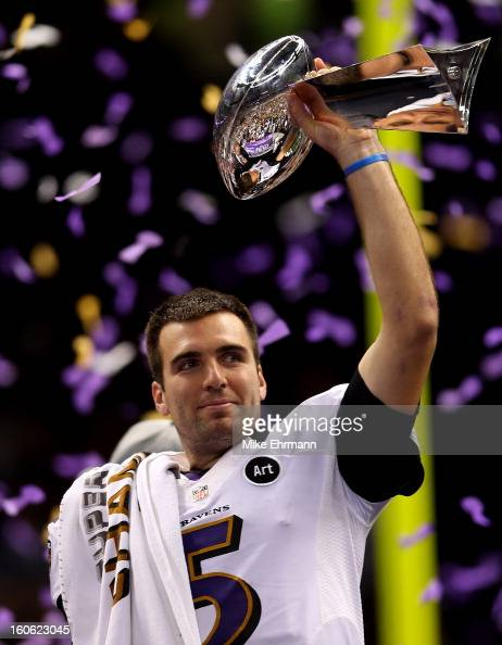 Joe Flacco of the Baltimore Ravens holds up the Vince Lombardi Trophy following their 3431 win against the Baltimore Ravens during Super Bowl XLVII...