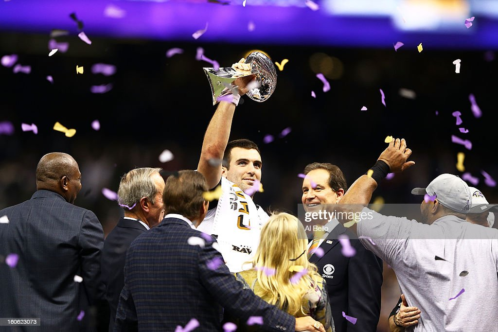 Joe Flacco #5 of the Baltimore Ravens holds up the Vince Lombardi Trophy next to CBS host Jim Nantz following their 34-31 win against the Baltimore Ravens during Super Bowl XLVII at the Mercedes-Benz Superdome on February 3, 2013 in New Orleans, Louisiana.