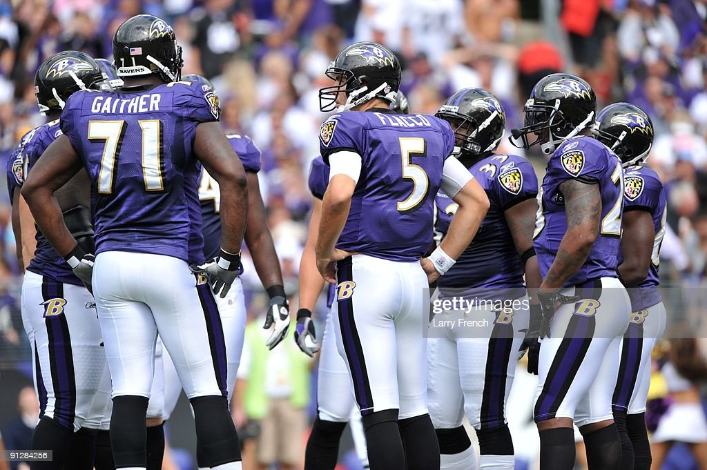 <a gi-track='captionPersonalityLinkClicked' href=/galleries/search?phrase=Joe+Flacco&family=editorial&specificpeople=4645672 ng-click='$event.stopPropagation()'>Joe Flacco</a> #5 of the Baltimore Ravens huddles with the offense during the game against the Cleveland Browns at M&T Bank Stadium on September 27, 2009 in Baltimore, Maryland. The Ravens defeated the Browns 34-3.