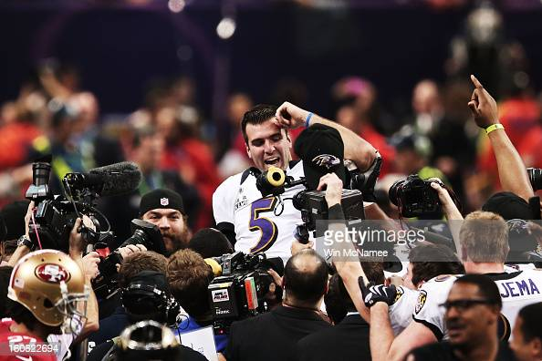 Joe Flacco of the Baltimore Ravens is lifted up by his teammates as they celebrate after they won 3431 against the San Francisco 49ers during Super...