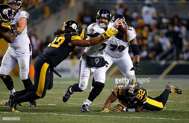 Joe Flacco of the Baltimore Ravens is pressured by Bud Dupree of the Pittsburgh Steelers in the first half during the game at Heinz Field on December...