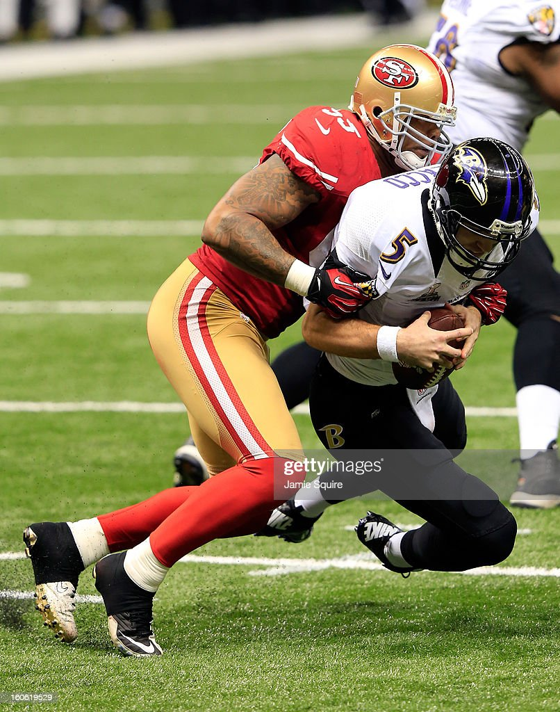 <a gi-track='captionPersonalityLinkClicked' href=/galleries/search?phrase=Joe+Flacco&family=editorial&specificpeople=4645672 ng-click='$event.stopPropagation()'>Joe Flacco</a> #5 of the Baltimore Ravens is sacked by <a gi-track='captionPersonalityLinkClicked' href=/galleries/search?phrase=Ahmad+Brooks&family=editorial&specificpeople=2326499 ng-click='$event.stopPropagation()'>Ahmad Brooks</a> #55 of the San Francisco 49ers in the second half during Super Bowl XLVII at the Mercedes-Benz Superdome on February 3, 2013 in New Orleans, Louisiana.