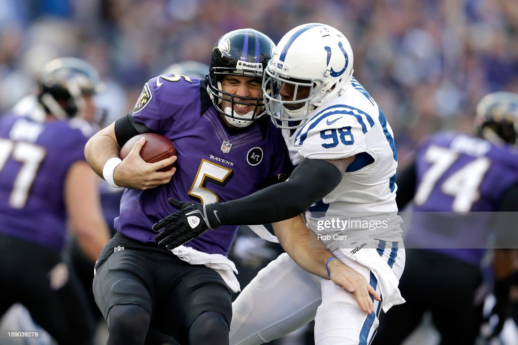 <a gi-track='captionPersonalityLinkClicked' href=/galleries/search?phrase=Joe+Flacco&family=editorial&specificpeople=4645672 ng-click='$event.stopPropagation()'>Joe Flacco</a> #5 of the Baltimore Ravens is sacked by <a gi-track='captionPersonalityLinkClicked' href=/galleries/search?phrase=Robert+Mathis&family=editorial&specificpeople=2108407 ng-click='$event.stopPropagation()'>Robert Mathis</a> #98 of the Indianapolis Colts in the third quarter during the AFC Wild Card Playoff Game at M&T Bank Stadium on January 6, 2013 in Baltimore, Maryland.