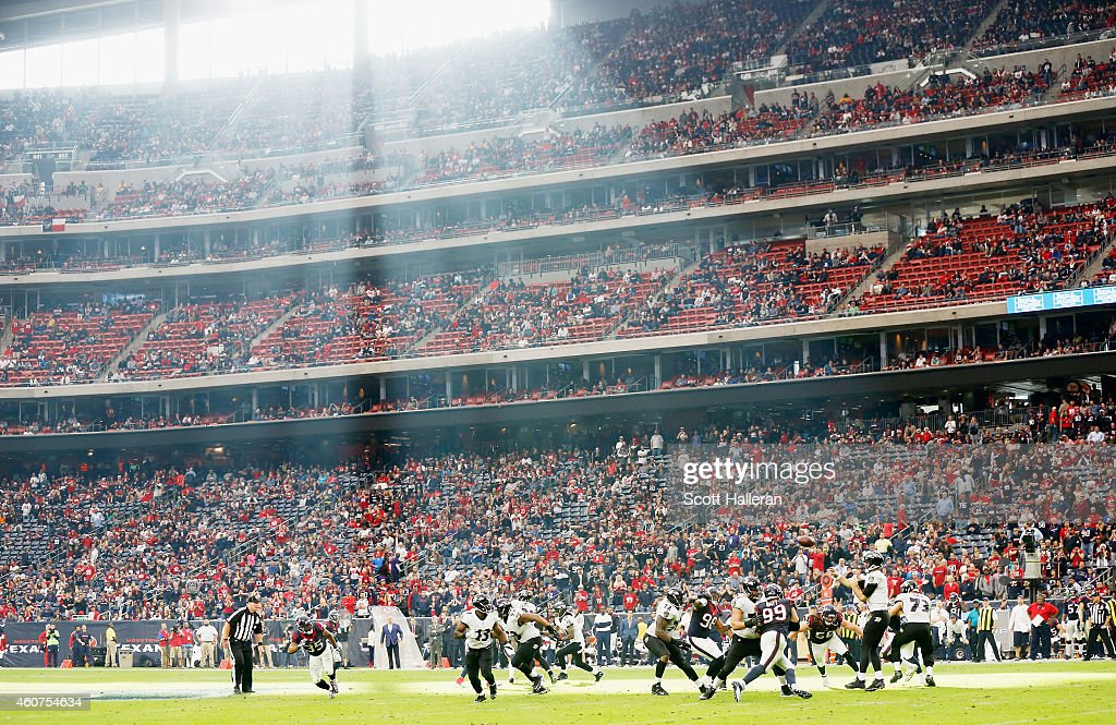 Joe Flacco #5 of the Baltimore Ravens looks to pass during the game against the Houston Texans at NRG Stadium on December 21, 2014 in Houston, Texas.