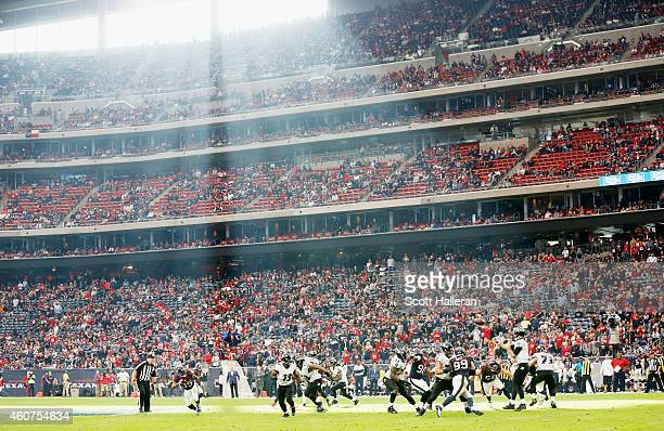 Joe Flacco of the Baltimore Ravens looks to pass during the game against the Houston Texans at NRG Stadium on December 21 2014 in Houston Texas
