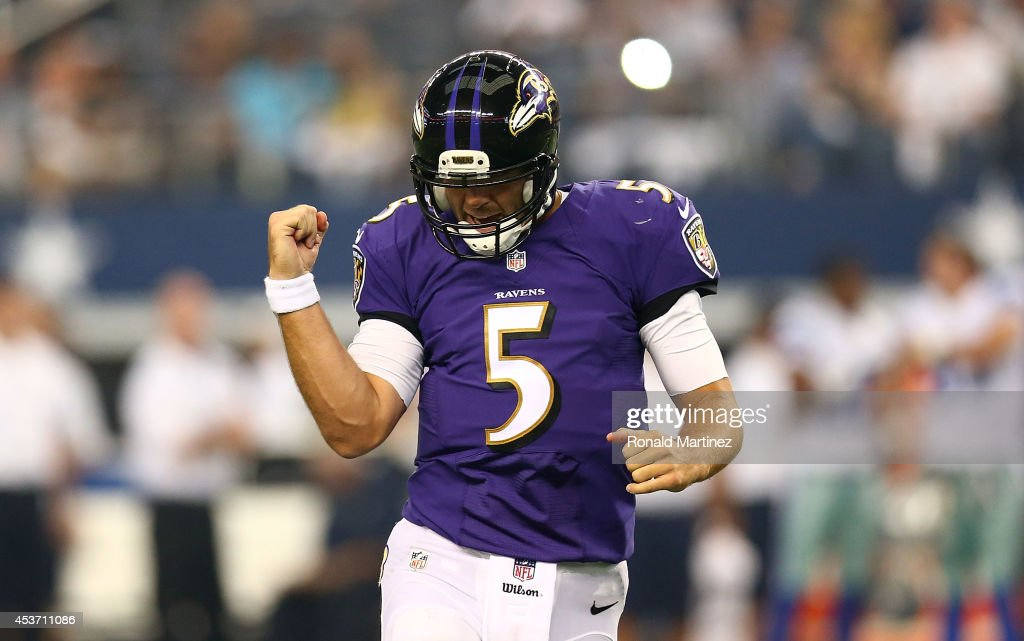 Joe Flacco of the Baltimore Ravens reacts against the Dallas Cowboys in the first half of the preseason game at ATT Stadium on August 16 2014 in...