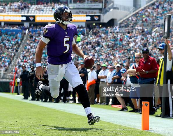 Joe Flacco of the Baltimore Ravens runs for a touchdown against the Jacksonville Jaguars at EverBank Field on September 25 2016 in Jacksonville...