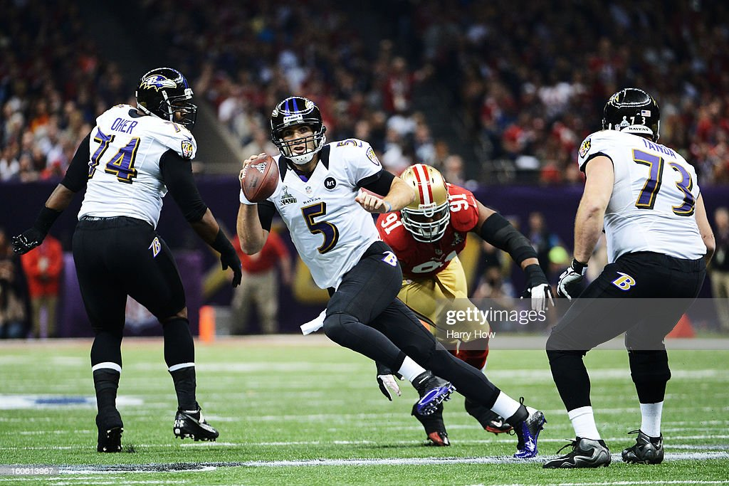 Joe Flacco #5 of the Baltimore Ravens scrambles with the ball in the first quarter against Ray McDonald #91 of the San Francisco 49ers during Super Bowl XLVII at the Mercedes-Benz Superdome on February 3, 2013 in New Orleans, Louisiana.