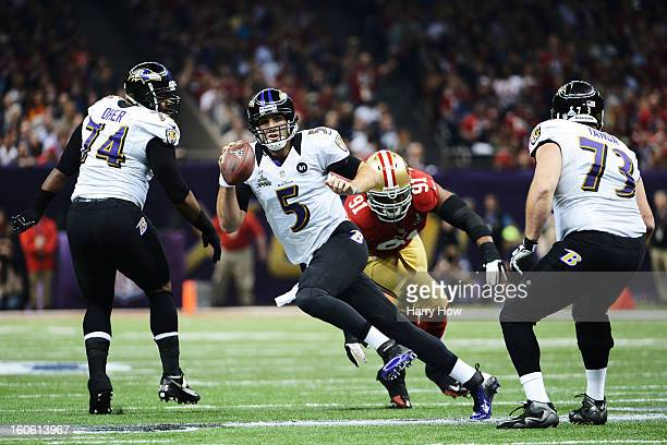 Joe Flacco of the Baltimore Ravens scrambles with the ball in the first quarter against Ray McDonald of the San Francisco 49ers during Super Bowl...