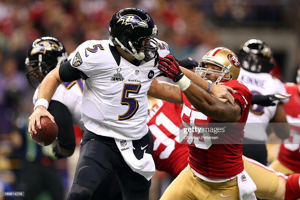 Joe Flacco #5 of the Baltimore Ravens scrambles with the ball in the first quarter under pressure from Ahmad Brooks #55 of the San Francisco 49ers during Super Bowl XLVII at the Mercedes-Benz Superdome on February 3, 2013 in New Orleans, Louisiana.