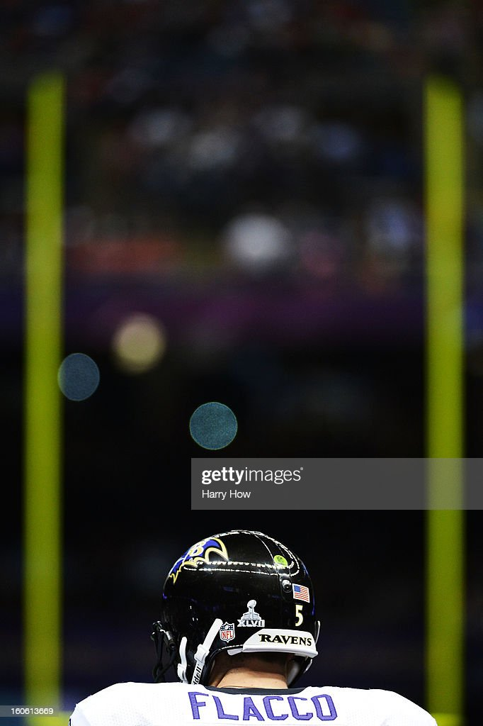 Joe Flacco #5 of the Baltimore Ravens stands on the field prior to kick-off against the San Francisco 49ers during Super Bowl XLVII at the Mercedes-Benz Superdome on February 3, 2013 in New Orleans, Louisiana.