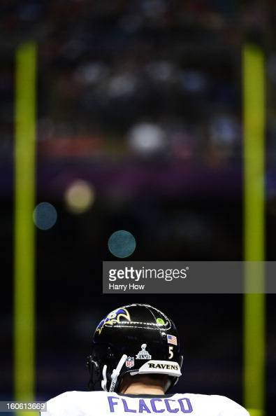 Joe Flacco of the Baltimore Ravens stands on the field prior to kickoff against the San Francisco 49ers during Super Bowl XLVII at the MercedesBenz...