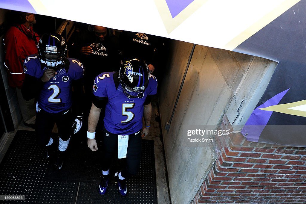 Joe Flacco #5 of the Baltimore Ravens walks out of the tunnel to the field for warm ups against the Indianapolis Colts during the AFC Wild Card Playoff Game at M&T Bank Stadium on January 6, 2013 in Baltimore, Maryland.