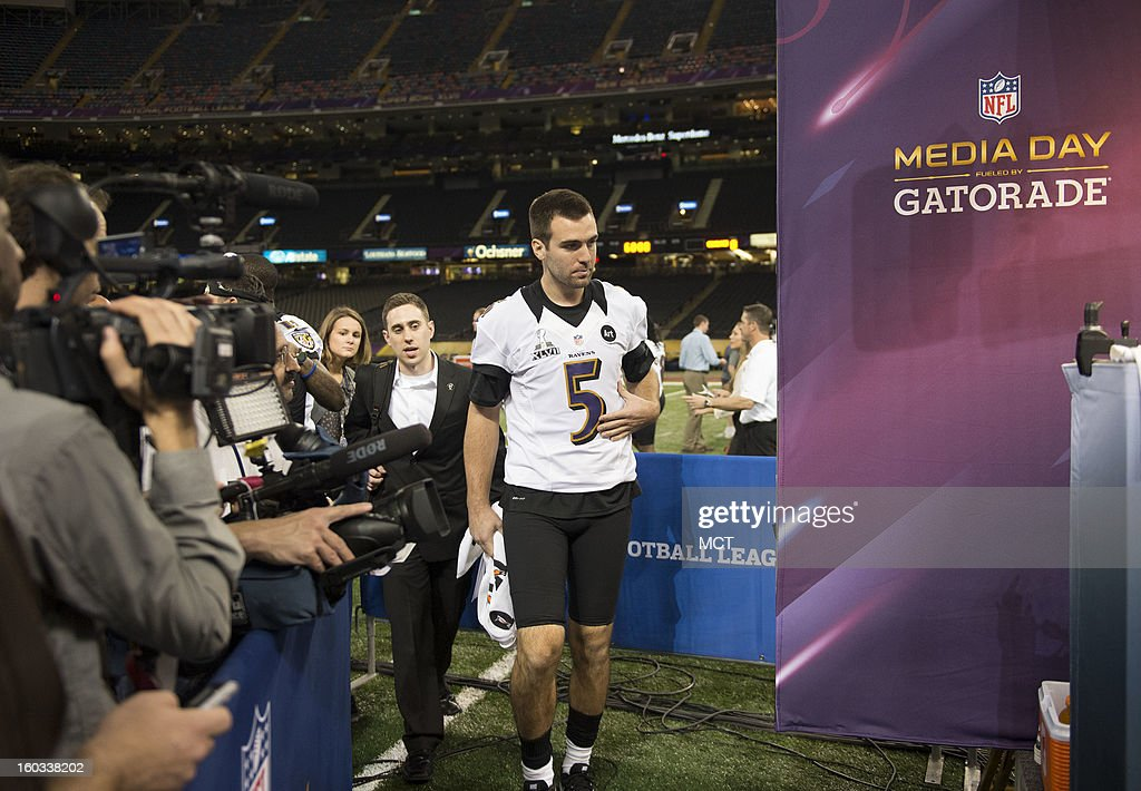 Joe Flacco of the Baltimore Ravens walks to his interview area during Super Bowl Media Day on Tuesday, January 29, 2013, in New Orleans, Louisiana.